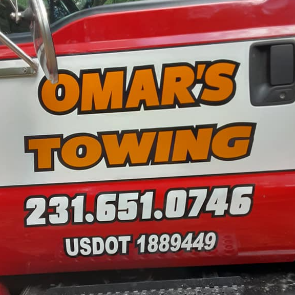 Omar's Towing logo